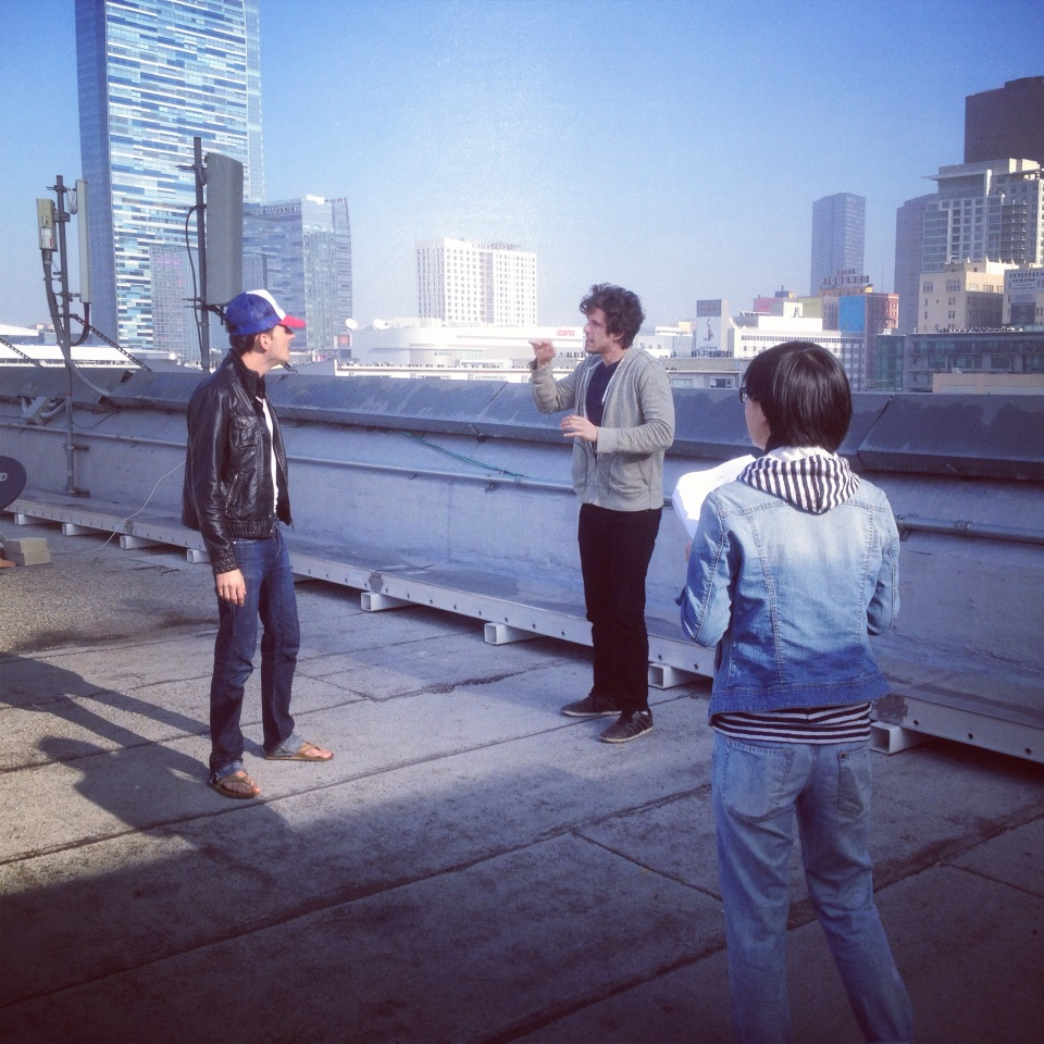Russell (middle) rehearsing on location with Eric Peterson (left) and Director Cheng Gong (Right).