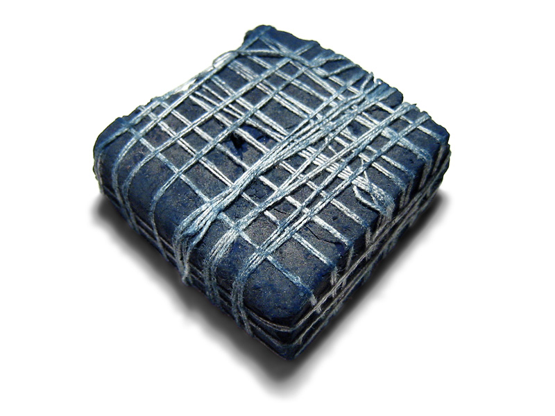Lump indigo from India - the blue sludge of indigo pigment is dried and sold in blocks
