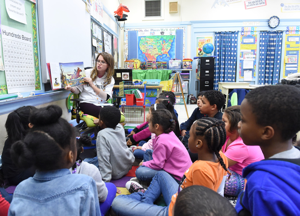 "10/19/2015 - Poughkeepsie, NY - Rachel Johnson, vice president of resource development at United Way of the Dutchess-Orange region, reads ""The Highway Rat"" to second-graders at Clinton Elementary School in the City of Poughkeepsie."