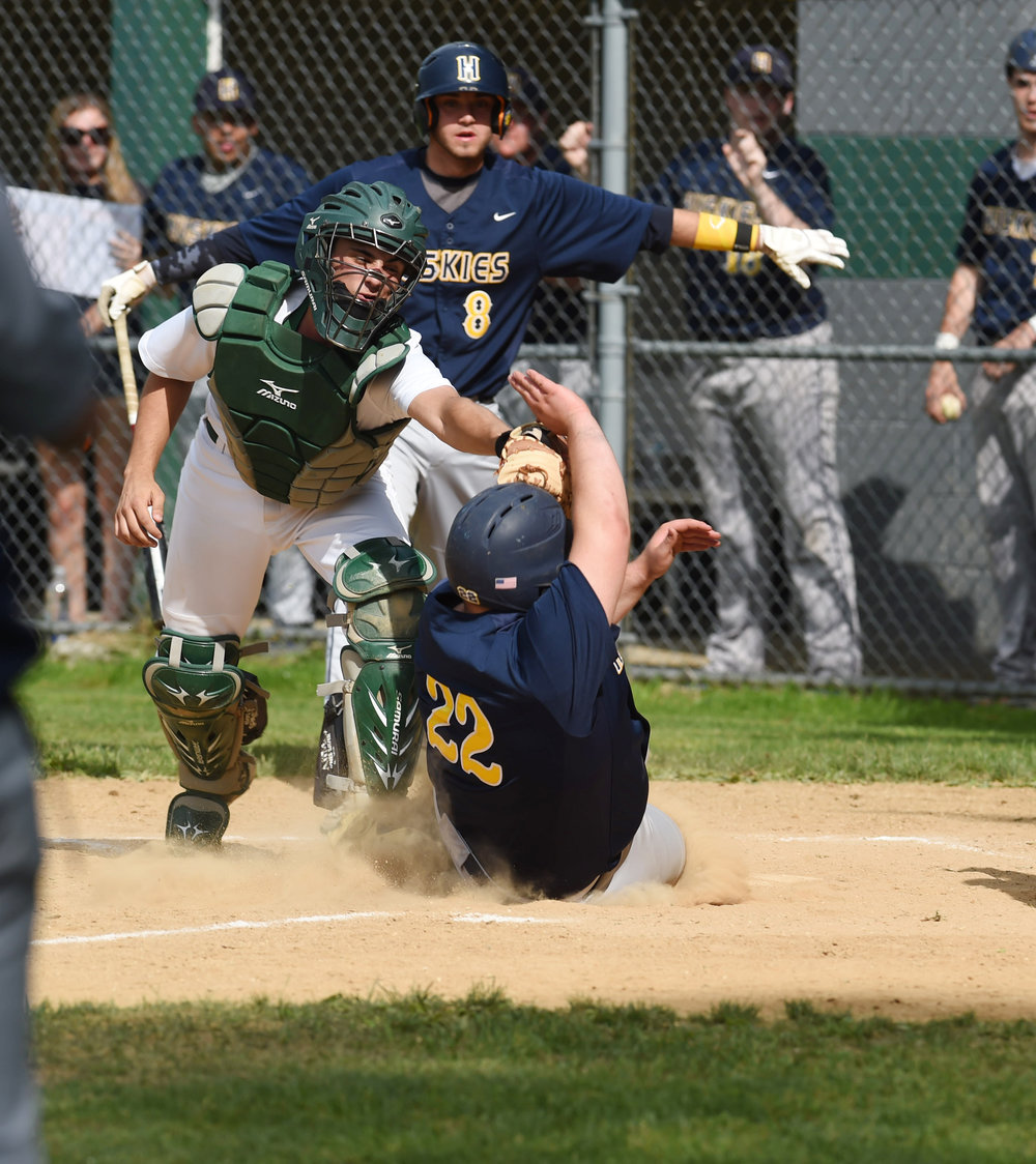 5/23/2016 - Poughkeepsie, NY - Spackenkill's Joe Arcuri, left, tags out Highland's Frank Alfonso, right, at home plate during Monday's game.