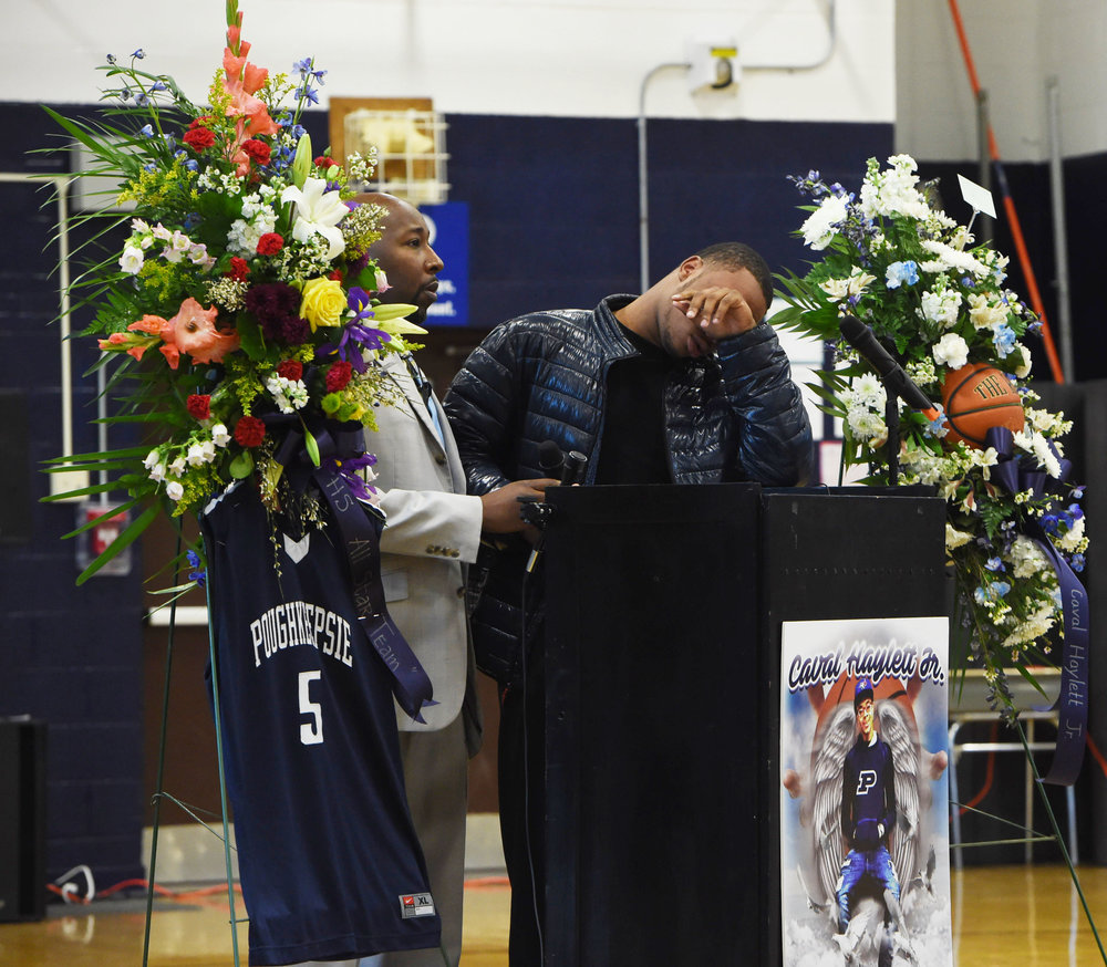 3/14/2016 - Poughkeepsie, NY - Akili Hill, 17, right, a student at Poughkeepsie High School and a member of the school's boys varsity basketball team, is overcome with emotion during the memorial for former teammate Caval Haylett Jr., who was shot on March 9. Assistant Principal Da'Ron Wilson, left, stands by with a microphone.   **Winner, News Photo of the Month, New York State Associated Press