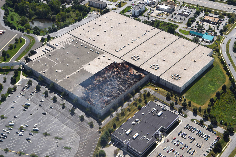 8/30/2016 - Fishkill, NY - This aerial shot of the Gap Inc. distribution center in Fishkill shows the damage left from a fire in one of the facility's buildings late Monday night into Tuesday morning.