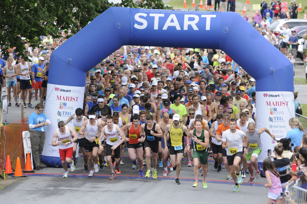 6/13/2015 - Poughkeepsie, NY - Runners begin the Walkway Marathon on the eastern bank of the Hudson River in Poughkeepsie, near Marist College's Boathouse.