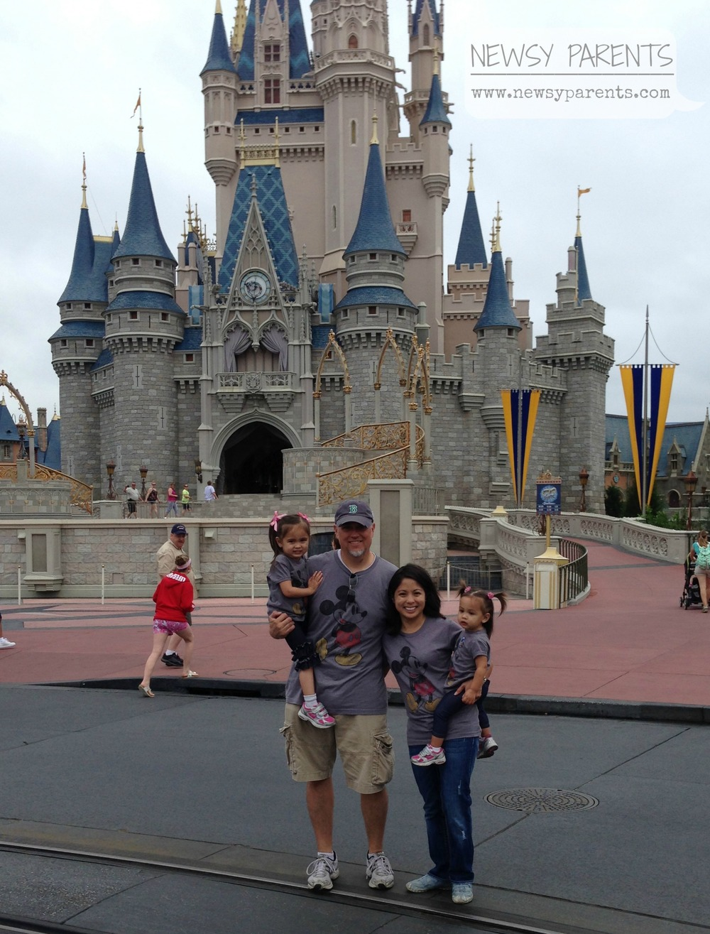First family picture in front of the famous Cinderella Castle at Walt Disney World wearing our matching Mickey Mouse shirts.