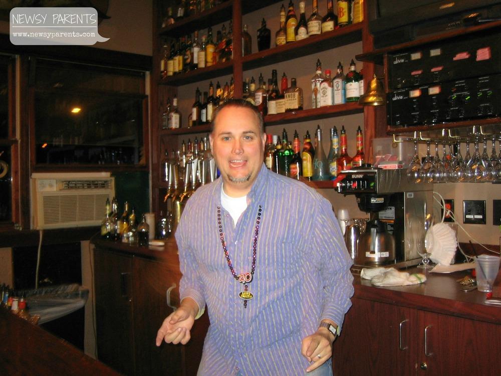 Newsy Parents Brian's bday behind bar.jpg