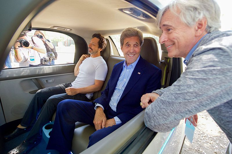 U.S. Secretary of State John Kerry chats with Google Co-Founder Sergey Brin and a leader of Google's Self-Driving Car Project while sitting inside one of Google's self-driving cars at the 2016 Global Entrepreneurship's Innovation Marketplace on the campus of Stanford University in Palo Alto, California, on June 23, 2016. [State Department photo/ Public Domain]. 23 June 2016, 12:44. U.S. Department of State from United States.