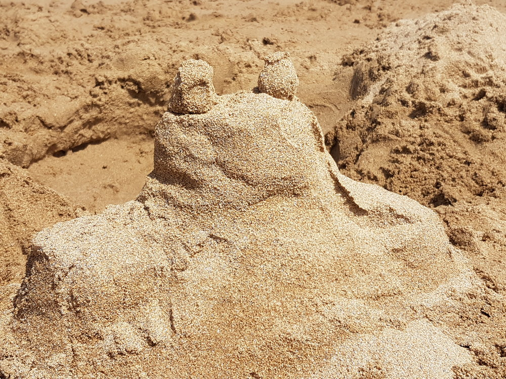 I went to the beach - and saw a sandcastle. And it looked like a big frog.