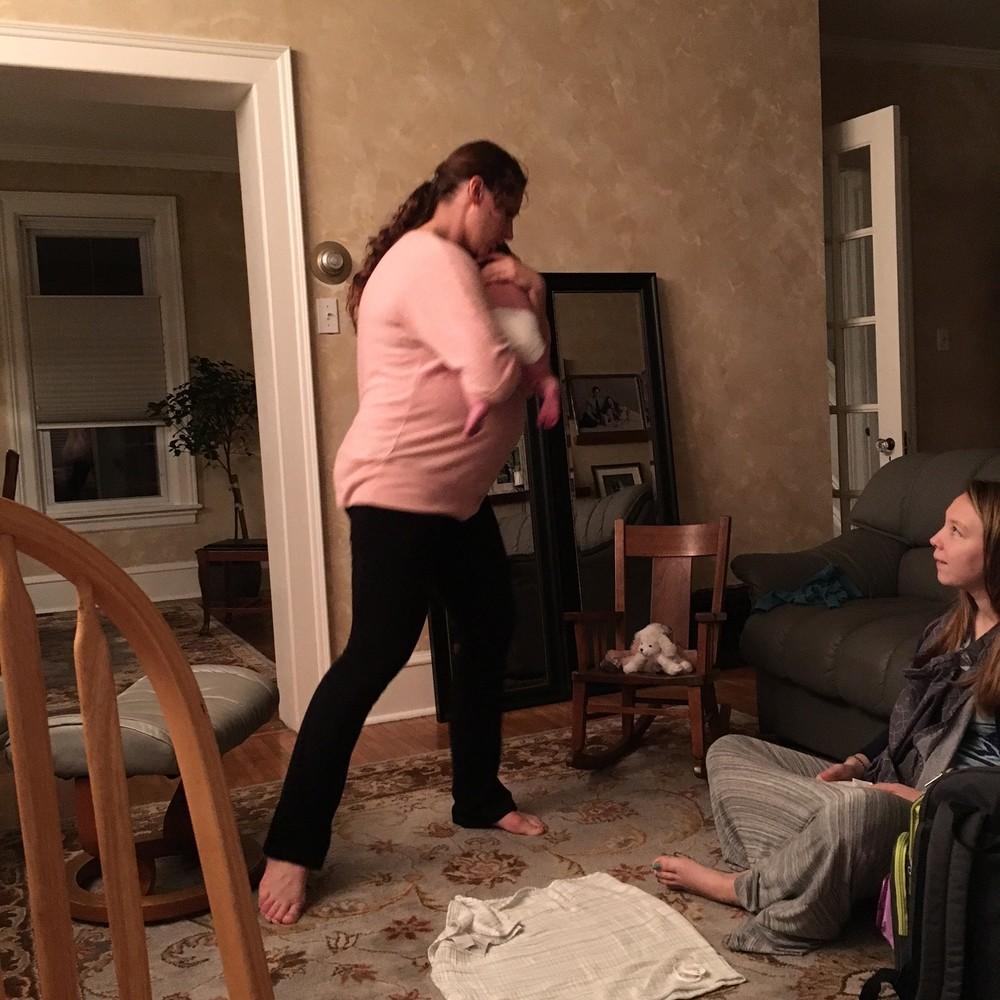 (In the pink: sister in law swinging and shushing. In her arms: her nephew, who did not take kindly to his first flight and being passed around at his shower and the longest day he'd ever had. On the floor: other sister in law, new mother of about two weeks, ready to lose her damn mind at her child, grateful for two minutes of quiet.)
