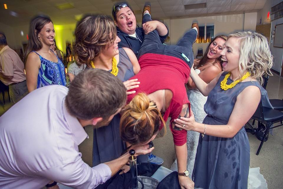 Yes, that's me being held by the bride doing a kegstand. The bride's the boss!