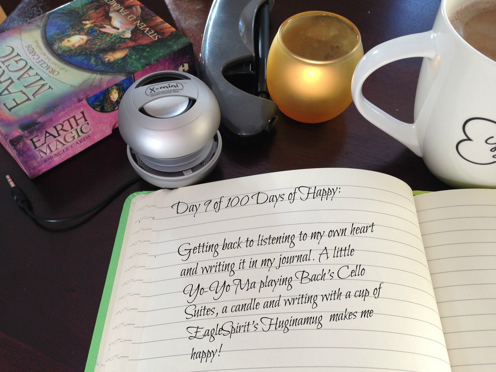 Day 9 of 100 Days of Happy: Getting back to listening to my own heart and writing it in my journal. A little Yo-Yo Ma playing Bach's Cello Suites, a candle and writing with a cup of EagleSpirit's Huginamug makes me happy!
