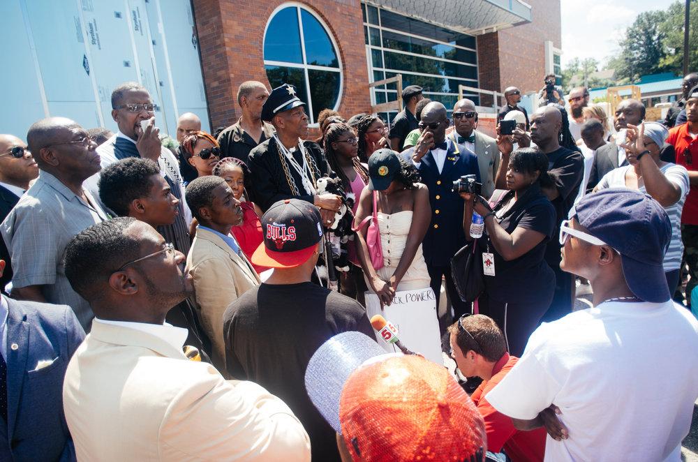 Protestors gather outside the Ferguson Police Department. Photo: Jamelle Bouie.