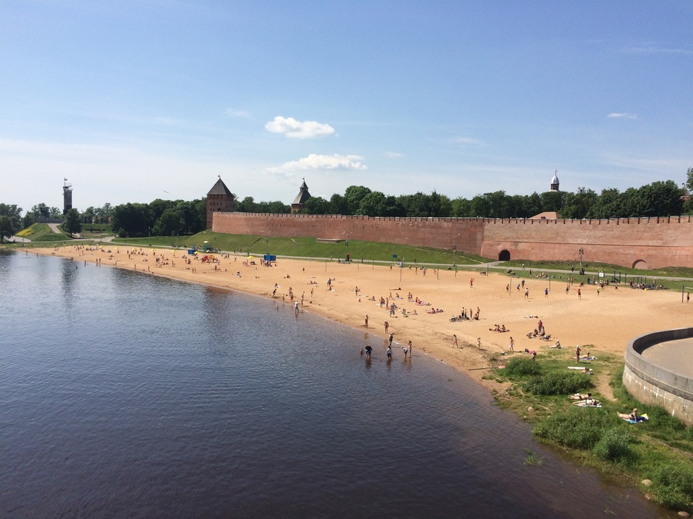 an old walled city with a river beach