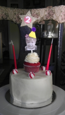 "8"" Red Velvet with standard cupcake and custom topper"