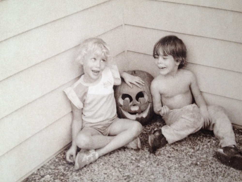 My sister and my cousin posing with their Jack-O-Lantern.