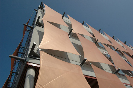 Hyparform vertical sails on a Vienna building by Planex