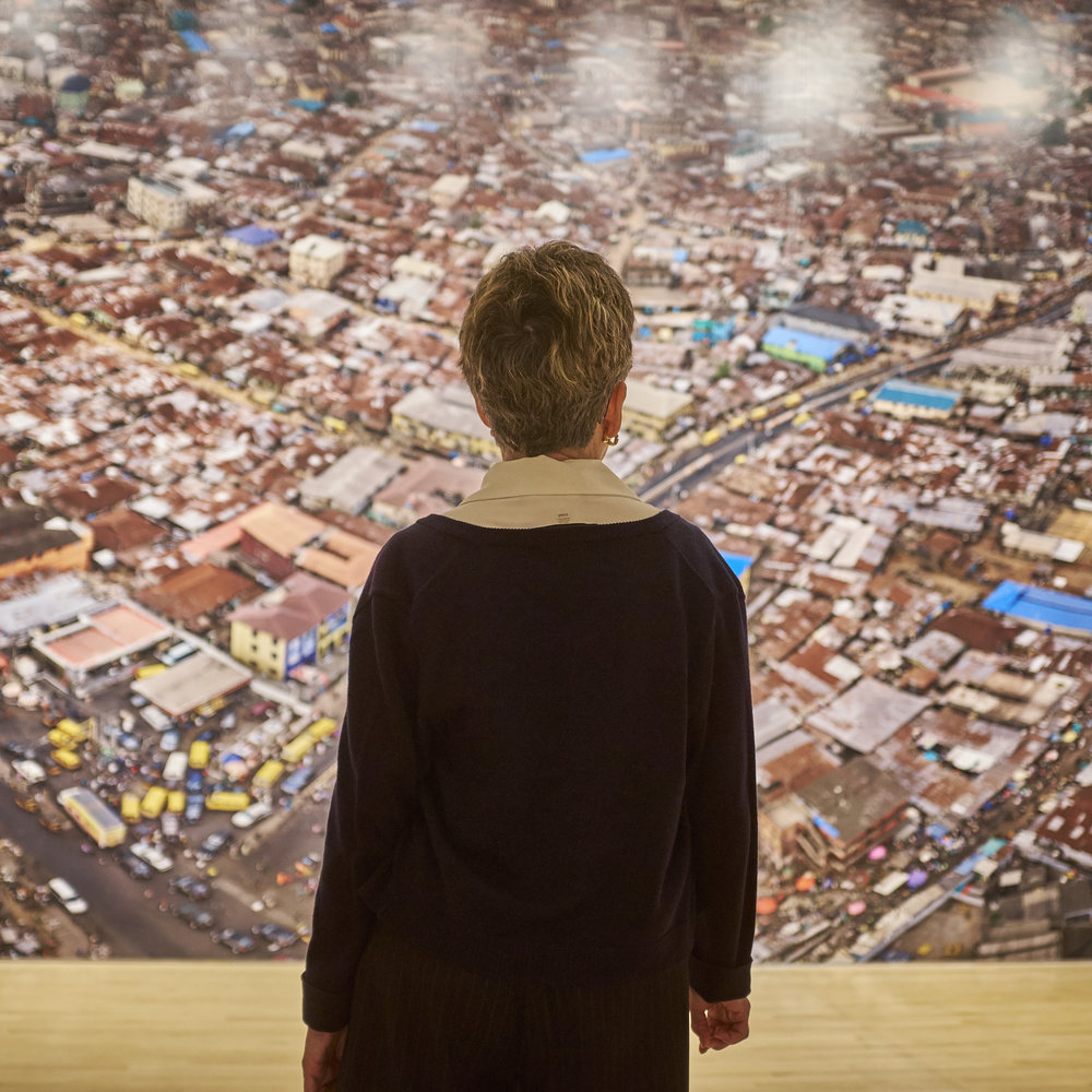A viewer in front of one of the large-scale images from  Anthropocene .