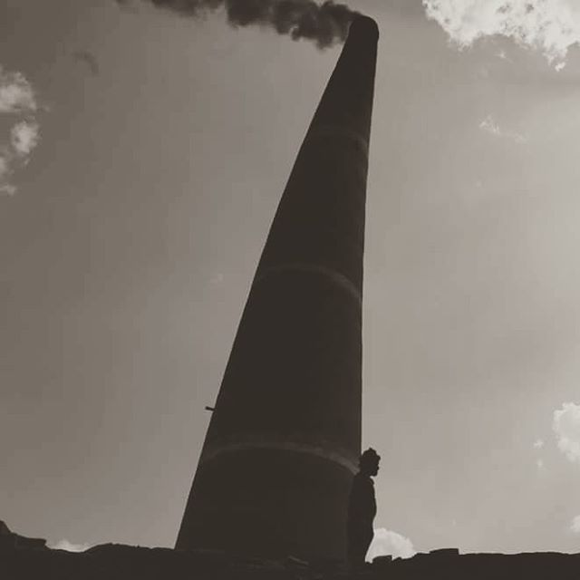 Kathmandu, Nepal is a city built of bricks... This is a smoke stack of one of the many brick baking furnaces used to make them. People of all ages take part in the process... Children and older women form the bricks in a mold and men bake the bricks in these furnaces... #tbt