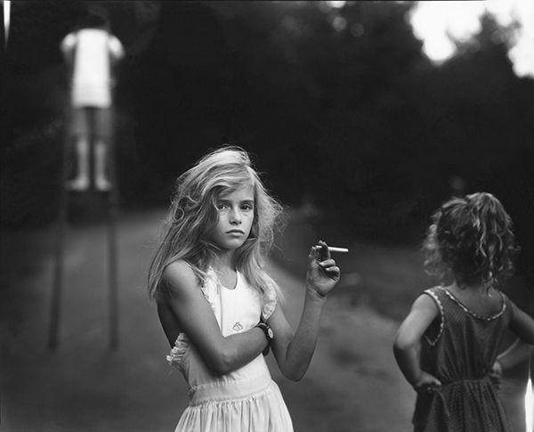 """Sally Mann,  Candy Cigarette  , 1989.Toned gelatin silver print.From the series  Immediate Family.          Normal   0           false   false   false     EN-US   X-NONE   X-NONE                                                                                                                                                                                                                                                                                                                                                                           /* Style Definitions */  table.MsoNormalTable {mso-style-name:""""Table Normal""""; mso-tstyle-rowband-size:0; mso-tstyle-colband-size:0; mso-style-noshow:yes; mso-style-priority:99; mso-style-parent:""""""""; mso-padding-alt:0in 5.4pt 0in 5.4pt; mso-para-margin-top:0in; mso-para-margin-right:0in; mso-para-margin-bottom:10.0pt; mso-para-margin-left:0in; line-height:115%; mso-pagination:widow-orphan; font-size:11.0pt; font-family:""""Calibri"""",""""sans-serif""""; mso-ascii-font-family:Calibri; mso-ascii-theme-font:minor-latin; mso-hansi-font-family:Calibri; mso-hansi-theme-font:minor-latin;}"""