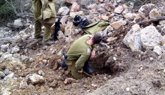 IDF Soldiers Examine Rocket After Hitting Northern Israel