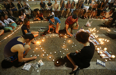 Teens gather in Tel Aviv's Rabin Square gather to mourn the loss of their teenage friends.