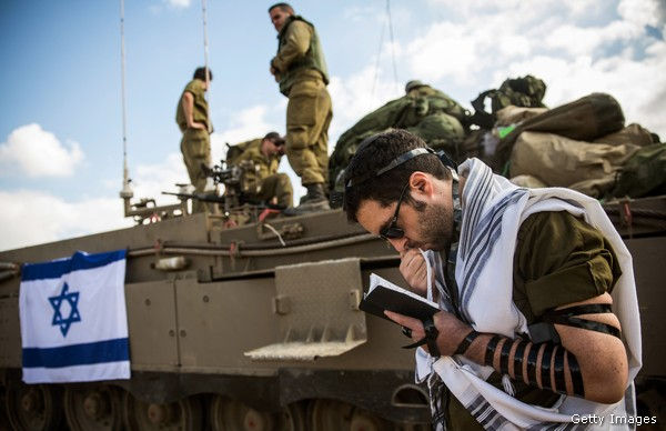 Israeli reservist prays near Gaza border July, 2014