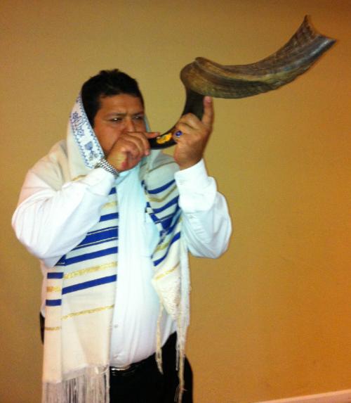 Ariel blows the shofar