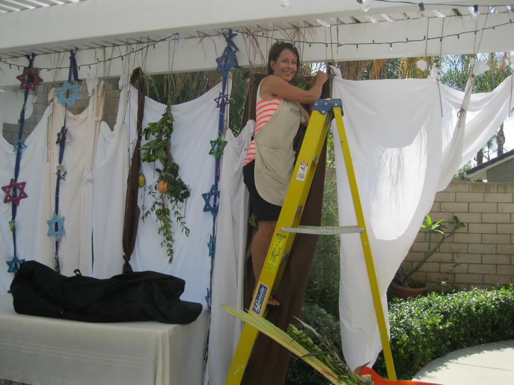 IMG_4265 Cindy hangs sheets.JPG