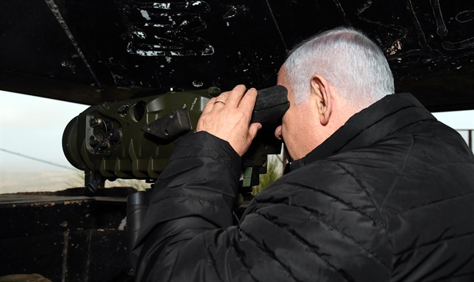 Prime Minister Netanyahu looks at the Syrian border from Northern Israel.