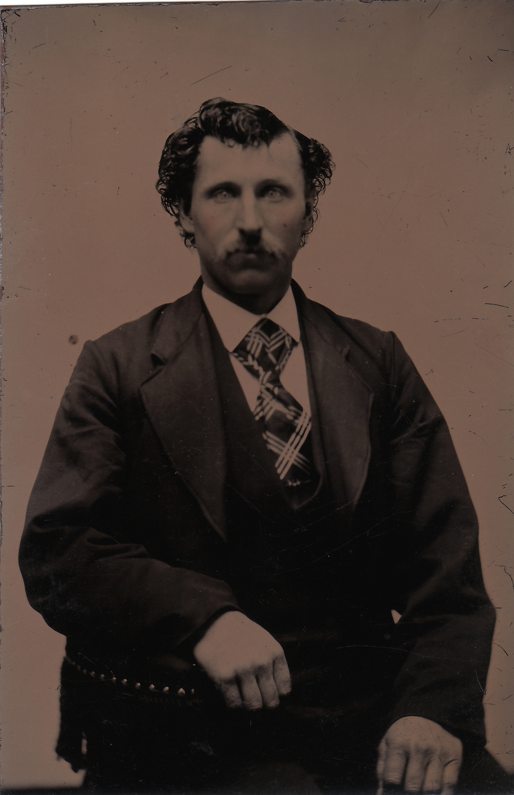 M. Castleton, 1896  Found tintype, 2014   M. Castleton's Tin Digital assembly with text, 22 January, 2015  M. Castleton's Tin is a collaboration between Jay Jurisich and  Tennyson Woodbridge  and may be reproduced in part or in full, expressly or unexpressedly,  assuming  it is credited as such...up until a period of 75 years, after which point any such credit will be strictly forbidden