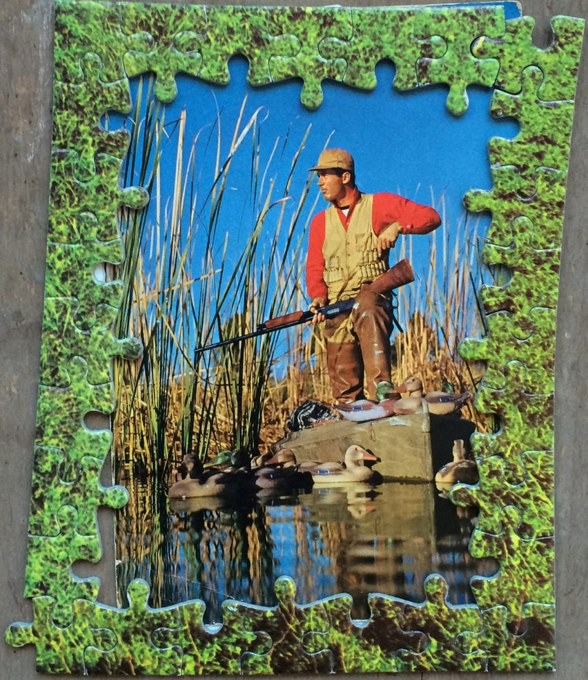 "Within the Reeds surveys Lloyd Barrington: Survivor at Large; 1968   2011; jigsaw on found card, ~5 x 3-3/4""   Collection Eli Davey; c  opyright © Tennyson Woodbridge, 1963 to present"
