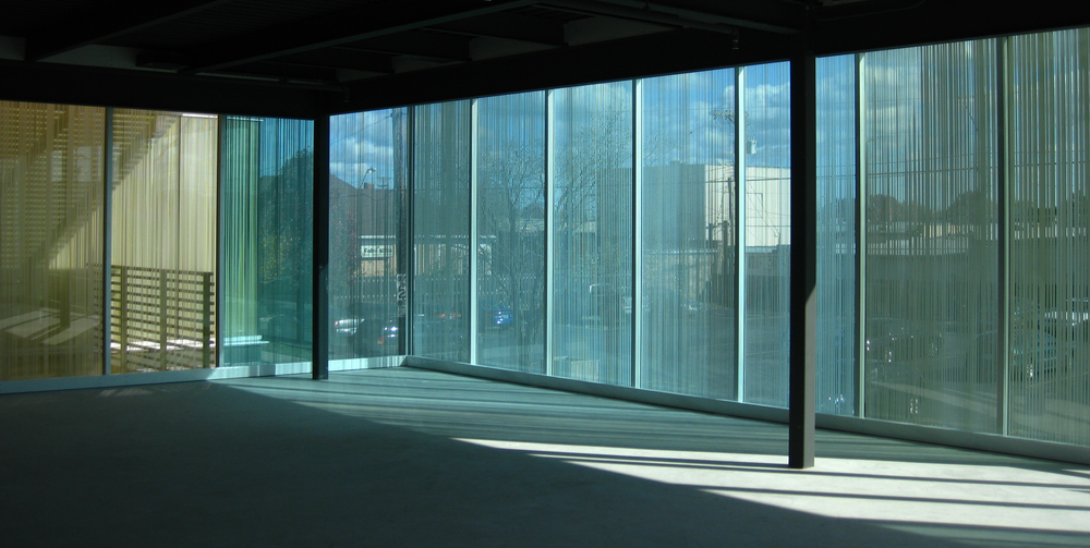 slips and shifts  2008  Private commission: custom glazing, dual layer ceramic frit. 52 total custom panels, 4' by 10' each, approximately 200' drawing in glass. Owner: Botwin & Company Architect:  el dorado architects  Kansas City, Missouri