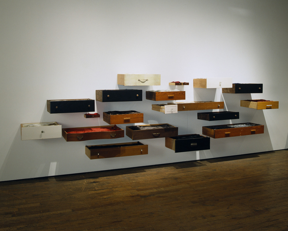 behold  2005 found wooden drawers, rayon thread 16 by 7 by 3 feet, variable shown in solo exhibition  silences  at Belger Art Center, 2005