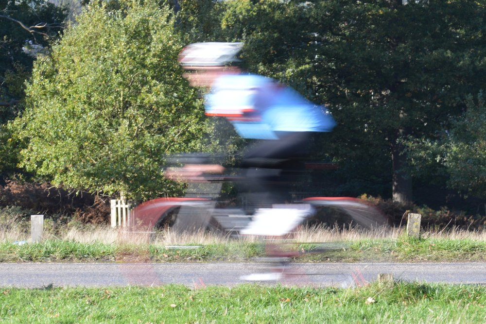 1/40   As above, some darker parts have now disappeared altogether. This is perhaps my favourite image as, although the movement is very blurred, you can still clearly see that it's a cyclist  moving through the frame. You can also still make out the cyclist's hands and facial features.