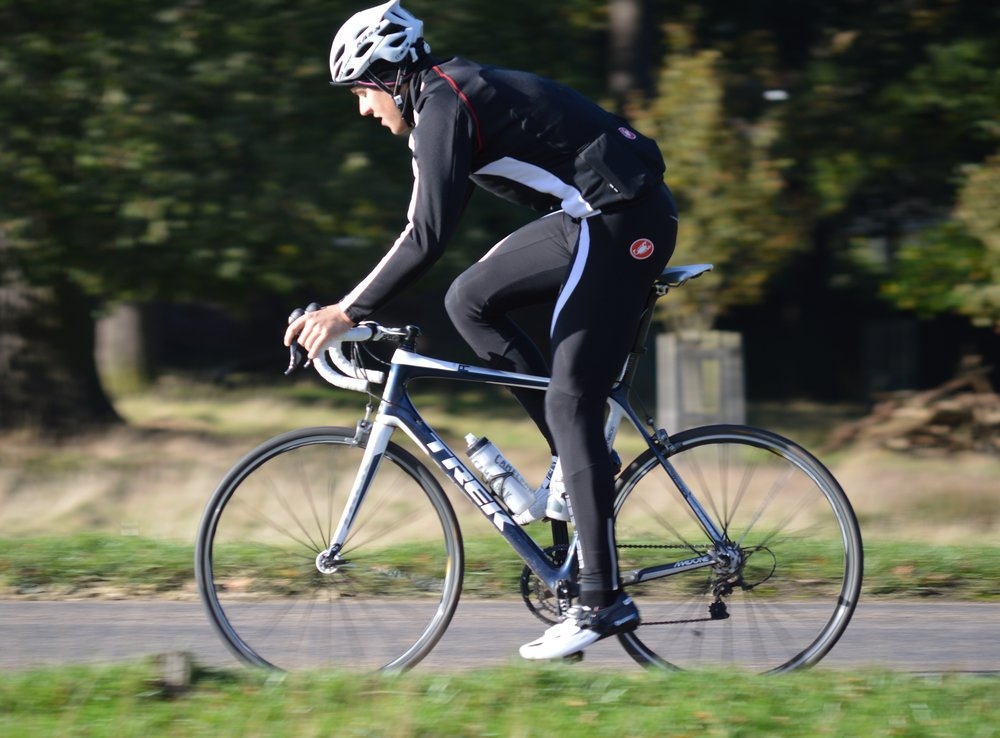 1/200   Here we can see a little more blurring of the background and foreground due to the panning camera. The cyclist remains sharply in focus , although there is now more blurring of the spokes and feet.