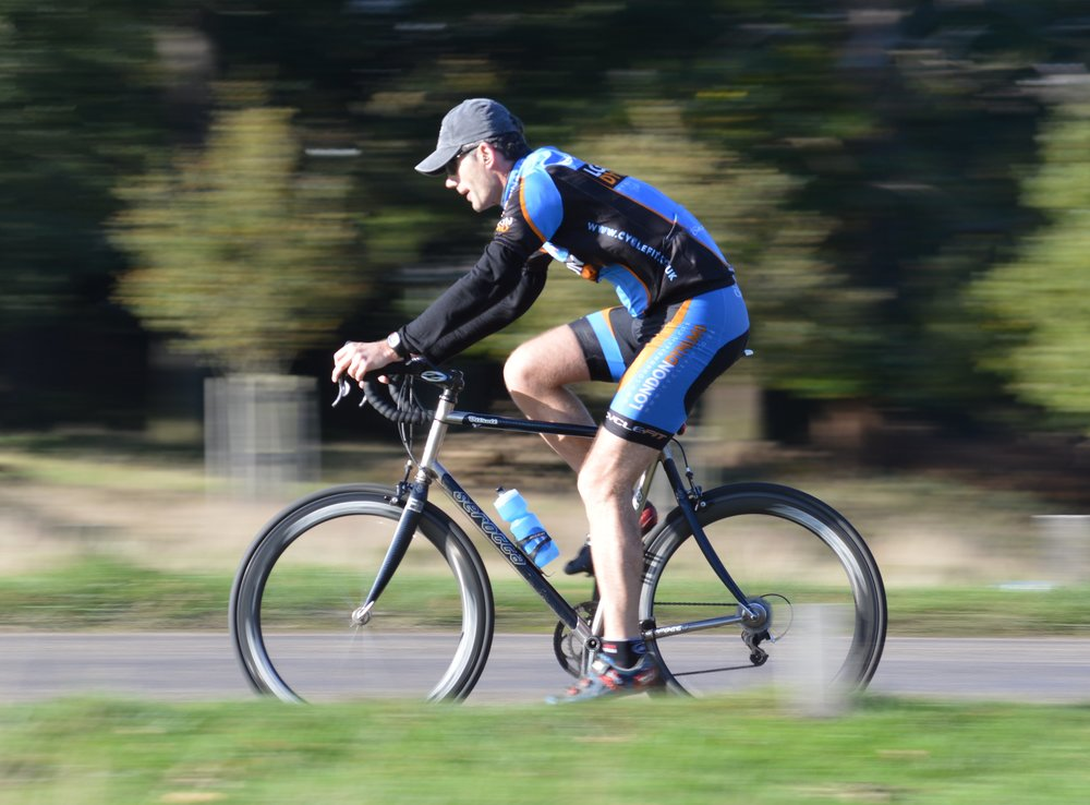 1/80 This one came out quite well. The wheels are nicely blurred, as is the scenery, but the cyclist himself is sharp.