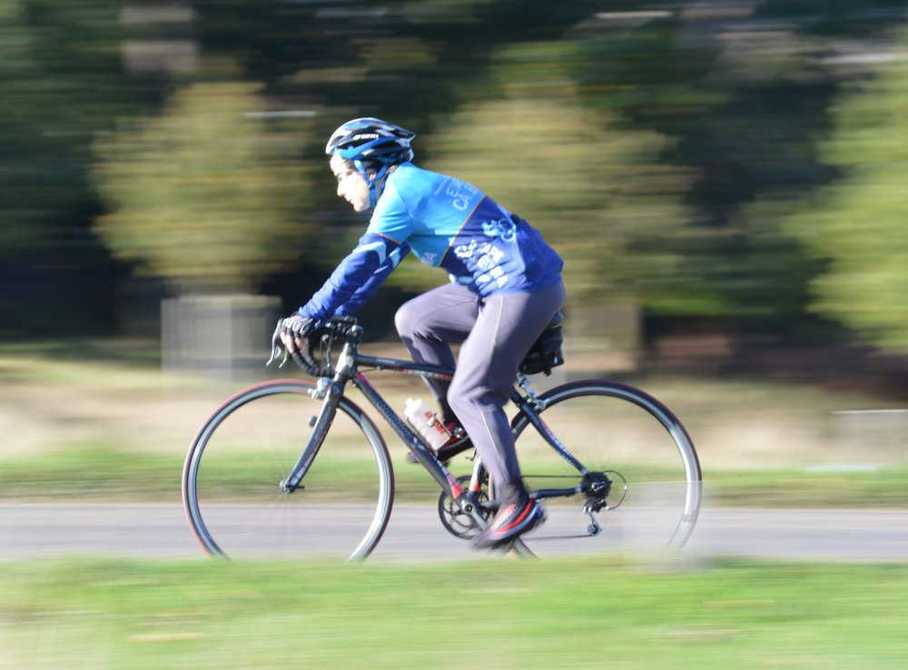 1/40 This cyclist now appears to be moving very fast compared to some of the earlier ones; an illusion created by the panning effect.