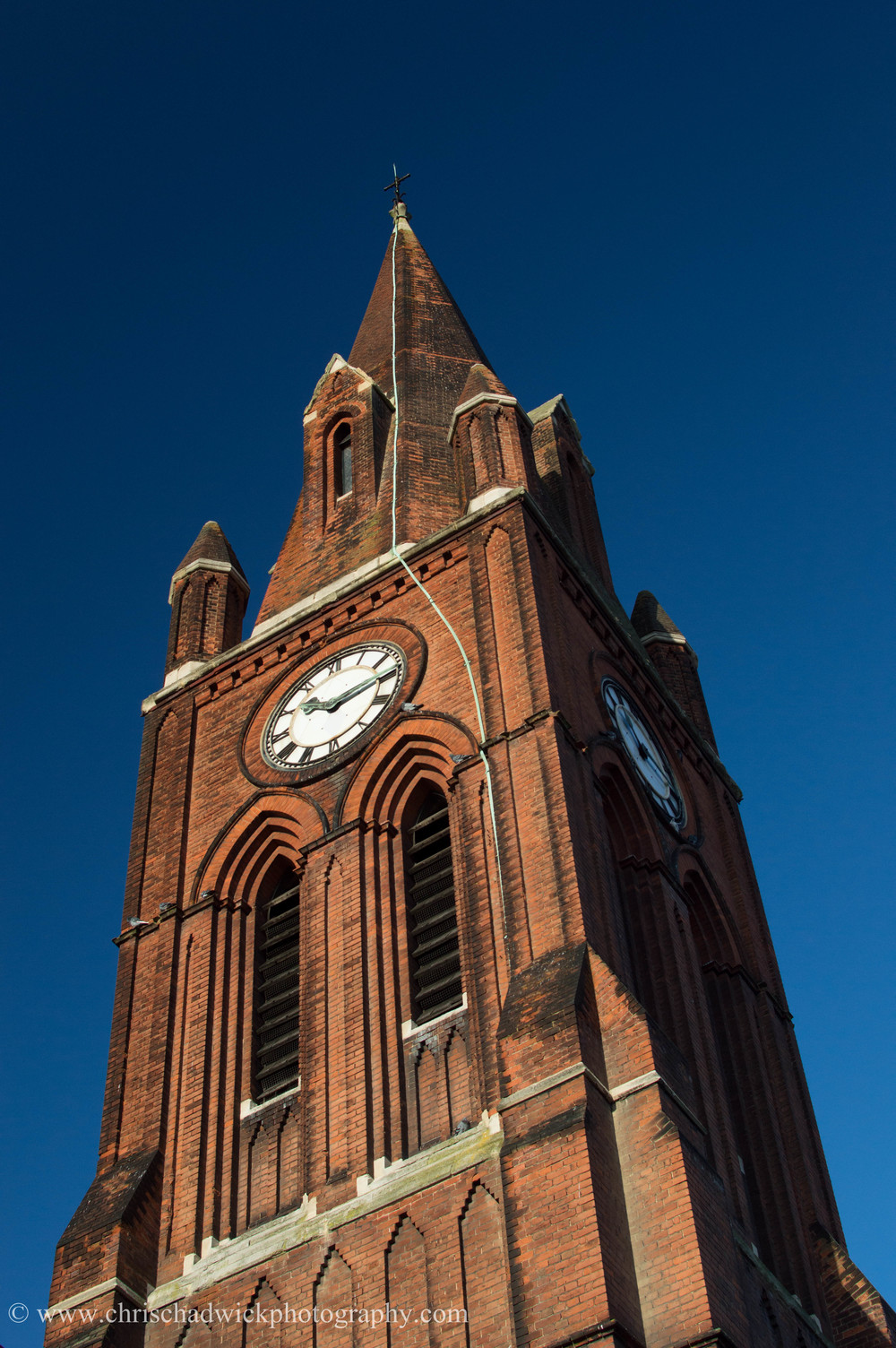 The church tower is much better in a portrait orientation, although neither look great due to the converging verticals.