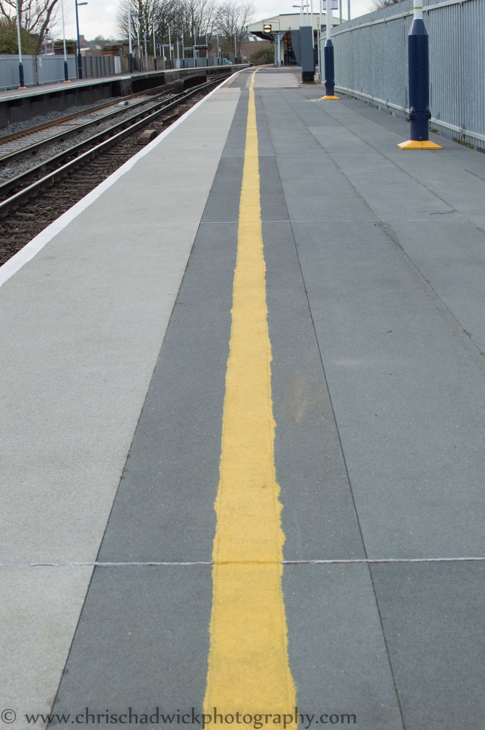This image works well in portrait orientation as several of the components lend themselves to the upright shape. The yellow line, the track and the platform all extend almost vertically away from the camera.