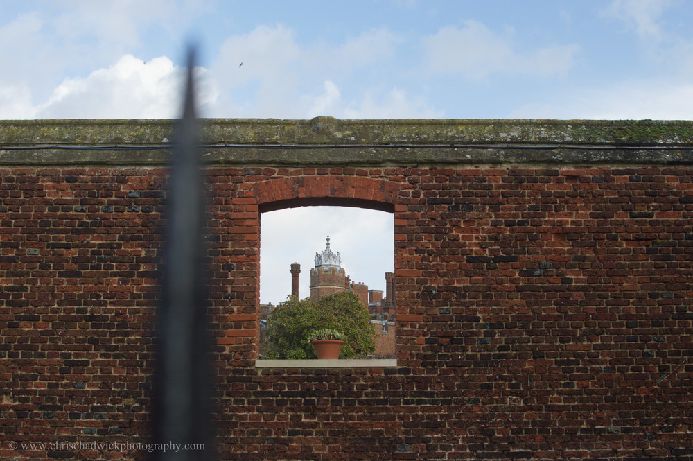 This uncropped images was taken from the other side of a metal fence looking through a window towards Hampton Court Palace. When I took it I think I intentionally included the metal spike but afterwards I realised it was a mistake. I knew the photograph had potential though.