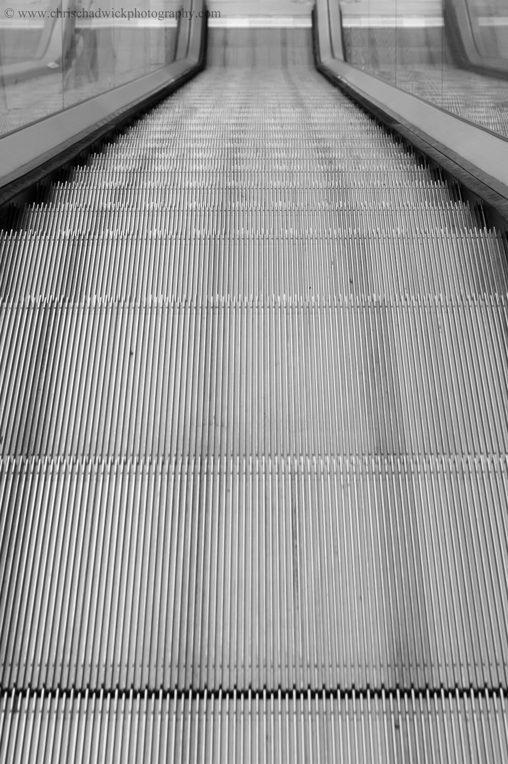 Continuous   Escalators go round and round and round continuously - until the stores close for the night.