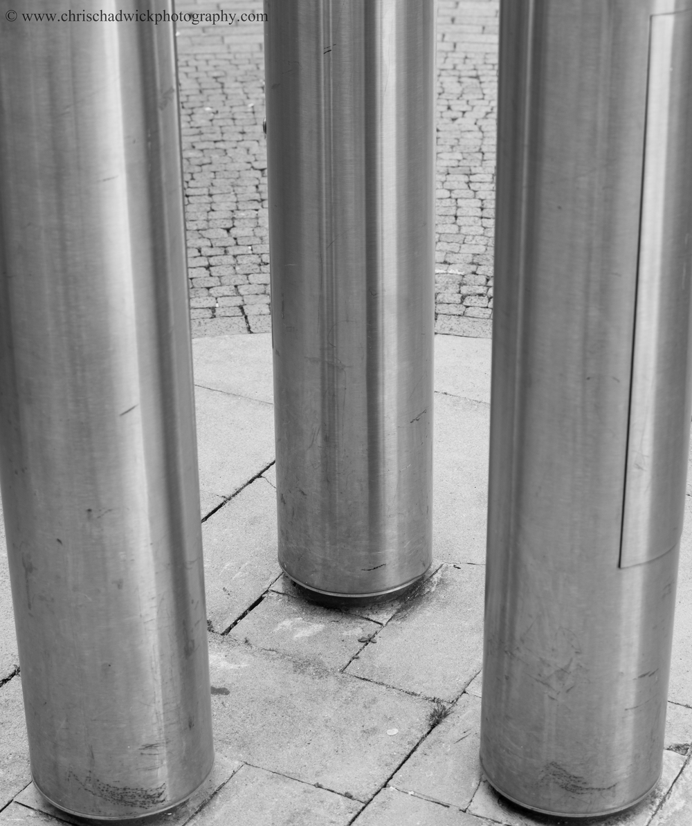 Implied triangle. These metal bollards (actually an art installation) form a clear implied triangle.
