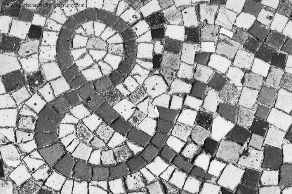 Several points in a deliberate shape.   A mosaic is a classic example of where individual points are laid out to form a distinct shape or pattern - in this case an ampersand. The shape is a little more complex than a standard element and I might perhaps have been better cropping down and selecting the circle at the top of the ampersand.