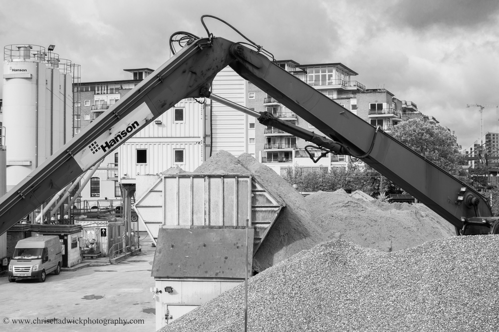 Implied triangle   The arm of this crane as well as the mound of sand and gravel below the apex, creates a triangular effect, enhanced by the use of an orange filter to darken the crane's arm.