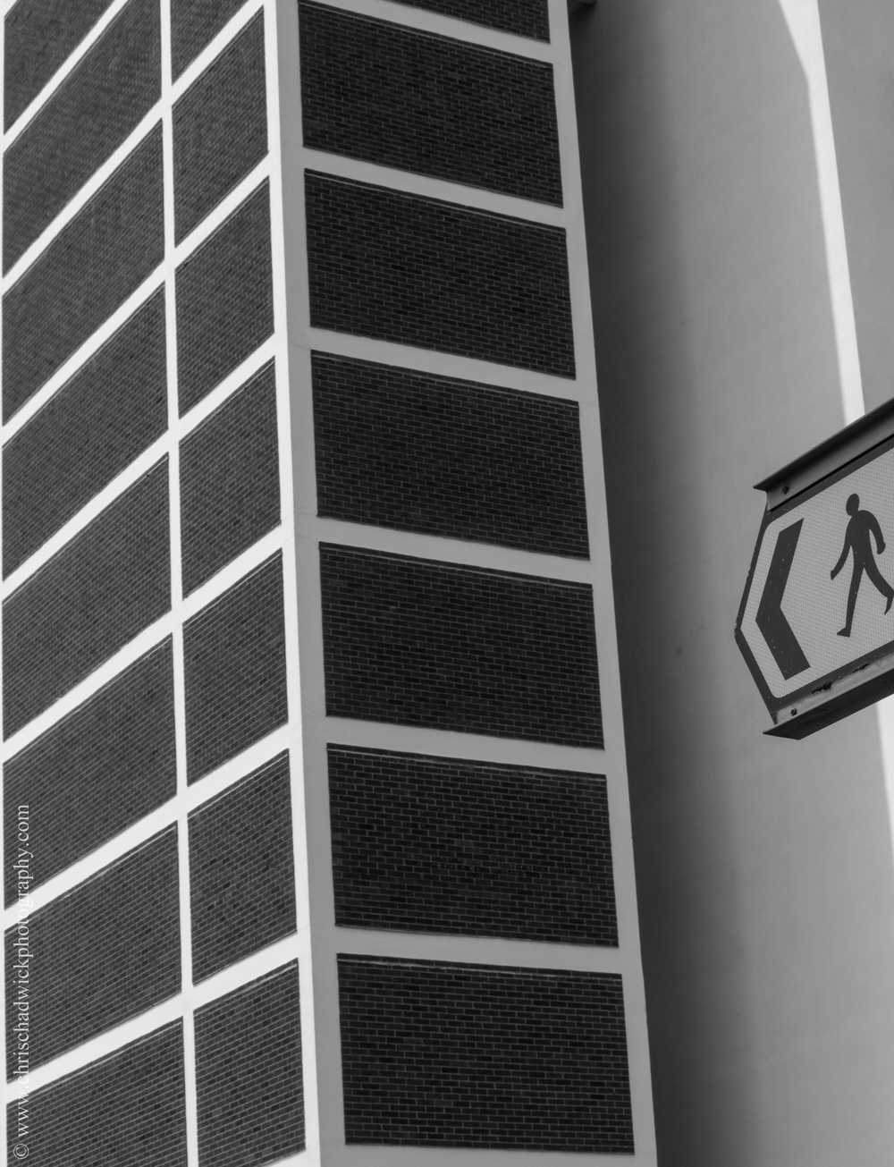 Distinct even if irregular shapes   I wasn't completely sure what type of image to use for this one, so I ended up choosing a fairly simple image showing rectangles and squares of brick used in the design of this block of flats. The signpost was kept in as it added a slight enigma to the image.