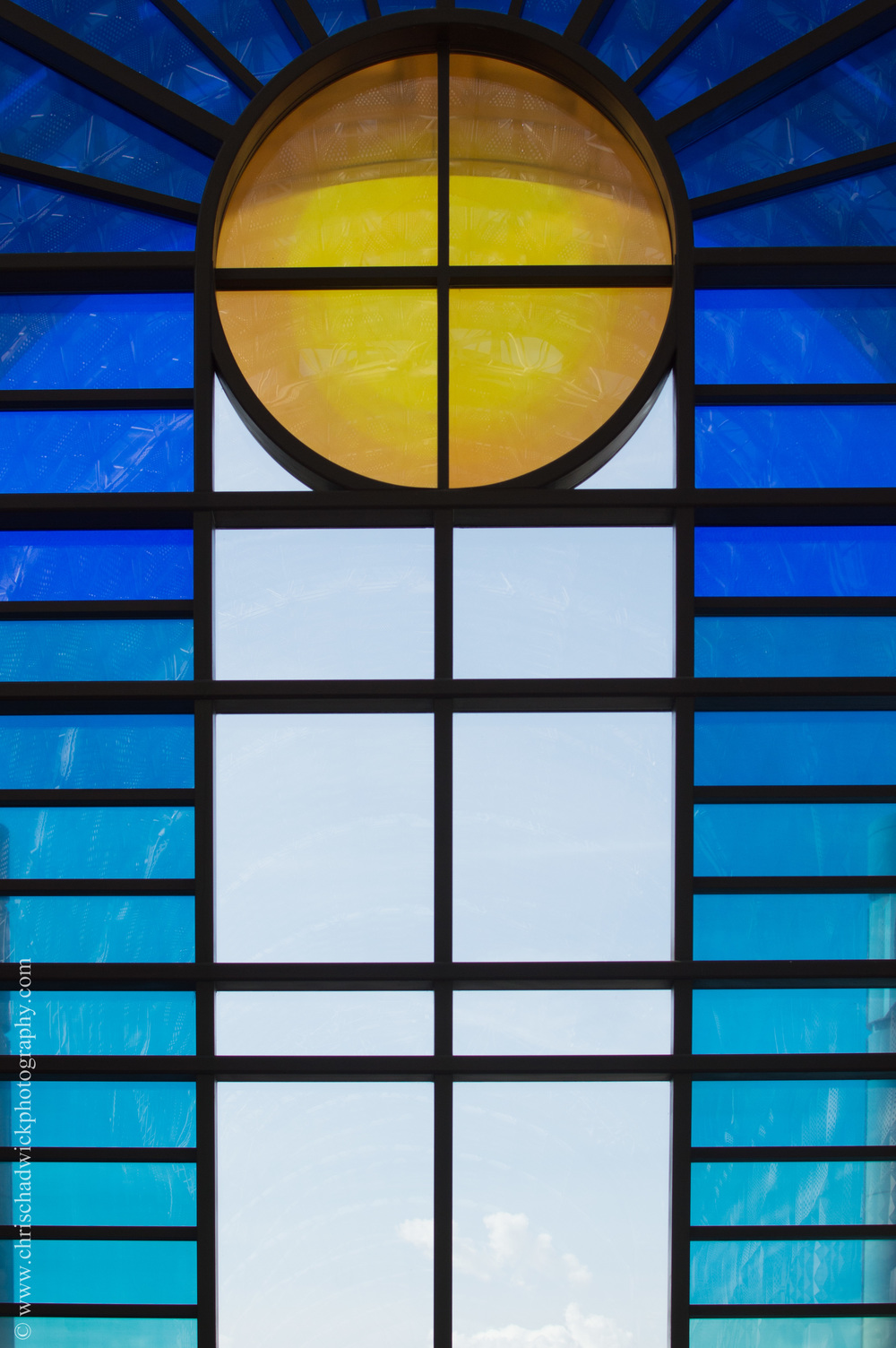Yellow and Blue Yellow and blue seem to be seen more together than orange and blue and I think they work well. This is the arched glass window in the Bentall Centre in Kingston which is perhaps a metaphor for the sun in the sky.