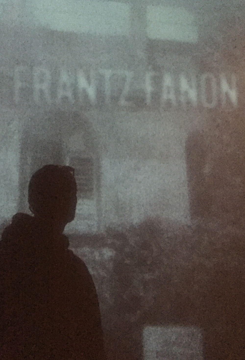 My shadow at the Frantz Fanon exhibition.