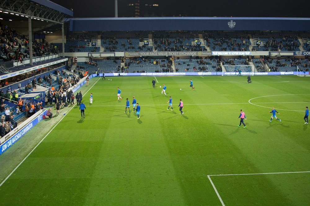 ISO 400 * 1/100s * 35mm * f/2.8 The mighty Blue & White Wizards (Sheffield Wednesday) warming up prior to their evening game against QPR in London. The lighting is supplied by the stadium floodlights.
