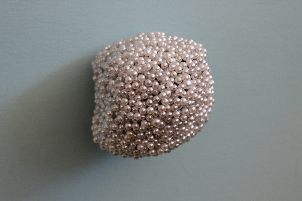 "Tickler #2  Pearl corsage pins, brass, industrial foam, 3 1/4"" x 3"" x 3"", 2012"