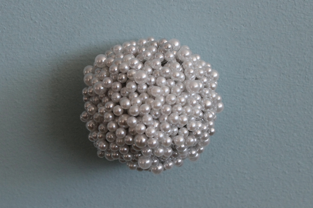 "Tickler #5  Pearl corsage pins, brass, industrial foam, 2 1/4"" x 2 1/4"" x 2"", 2009-2012"