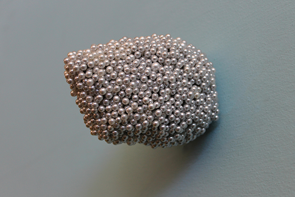 "Tickler #8  Pearl corsage pins, brass, industrial foam, 2 1/4"" x 2 1/2"" x 4"", 2012"